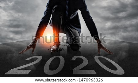 Businessman Starting to new year,The readiness of leaders, vision and new ideas are beginning in 2020. Royalty-Free Stock Photo #1470963326