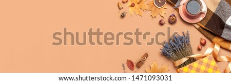 Autumn Flat lay composition. Cup of tea, autumn dry leaves, roses flowers, lavender, gift bag cones decorative pomegranate cinnamon sticks on brown background top view. Autumn, fall concept.  #1471093031