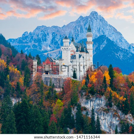 Amazing autumn view on Neuschwanstein Castle with colorful trees and the Alps on background, Bavaria, Germany. Beautiful autumn colorful scenery. #1471116344