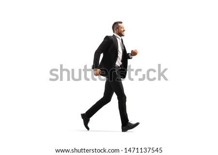 Full length profile shot of a businessman in a black suit running and smiling isolated on white background #1471137545