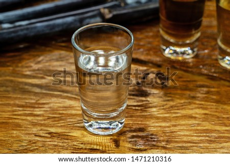 Several glasses of brazilian cachaça isolated on rustic wooden background, variations and types of brazil cachaça, typical drink from brazil. #1471210316