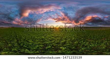 full seamless spherical hdri panorama 360 degrees angle view among fields in summer evening sunset with awesome blue pink red clouds in equirectangular projection, ready for VR AR virtual reality