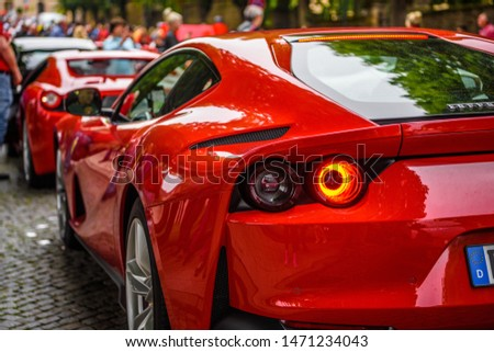 GERMANY, FULDA - JUL 2019: red FERRARI 812 SUPERFAST Type F152M is a front mid-engine, rear-wheel-drive grand tourer produced by Italian sports car manufacturer Ferrari that made its debut at the 2017 #1471234043
