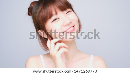 Asian Woman Looking At The Camera Standing On White Background #1471269770