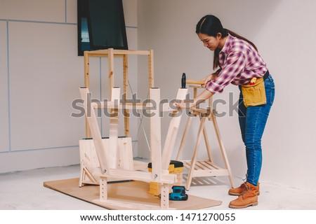 woman worker in the carpenter workroom. #1471270055