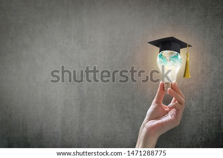 Innovative learning, creative educational study concept for graduation and school student success with world lightbulb on teacher chalkboard #1471288775