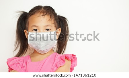 Little girl wear protect mask on white background                #1471361210