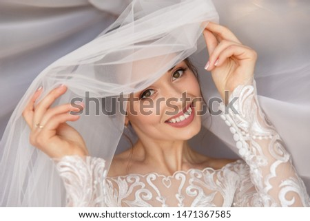 Wedding portait of happy bride. Gorgeous beauty young bride portrait. Beautiful bride with wedding makeup in white wedding veil. Bridal fashion model posing in interior. #1471367585