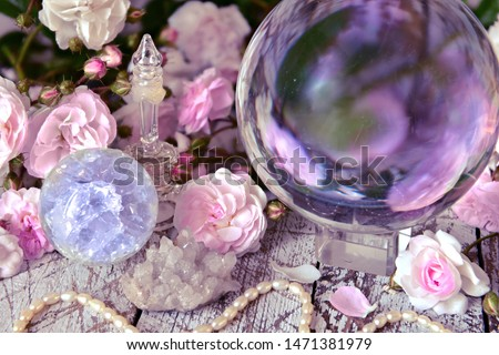 Still life with magic crystal ball, pink roses and necklace.  Esoteric, wicca and occult background, fortune telling and divination ritual with tarot cards.  #1471381979