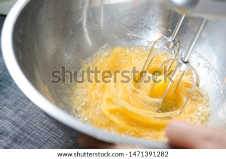 Electric Mixer Beaters Beating Eggs,Beating eggs with electric mixer beaters,Beating eggs before make bakerry #1471391282