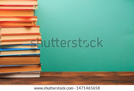 pile of old books, panorma, good copy space  on blue background - Image  #1471465658