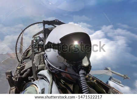 Fighter pilots cockpit view on routine flight Royalty-Free Stock Photo #1471522217