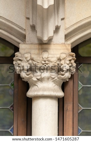 Elements of architecture of buildings, ancient arches, columns, windows, stucco molding and patterns. On the streets in Catalonia, public places. #1471605287
