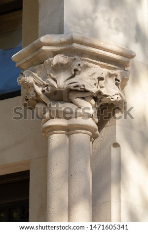 Elements of architecture of buildings, ancient arches, columns, windows, stucco molding and patterns. On the streets in Catalonia, public places. #1471605341