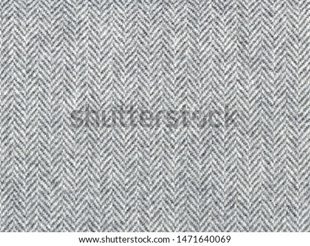 Herringbone tweed, Wool Background Texture. Coat close-up. Expensive men's suit fabric. Virgin wool extra-fine. High resolution. #1471640069