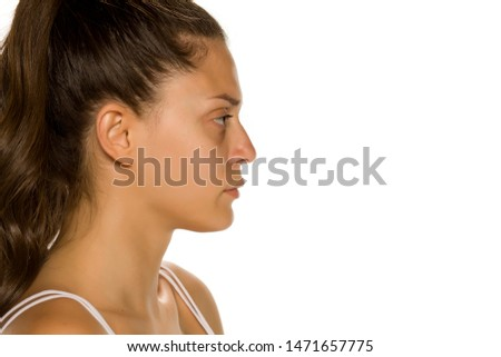 Profile of bautiful young woman without makeup on white background #1471657775