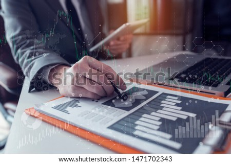 Businessman using a calculator with laptop and tablet on digital interface. innovation, icon and media information on network connection, Multi exposure, Concept of hight technology theme hologram. #1471702343