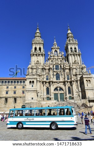 Santiago de Compostela, Spain. July 28, 2019. Cathedral with old bus and pilgrims. #1471718633