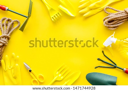 Gardening tools frame on yellow background top view mockup #1471744928