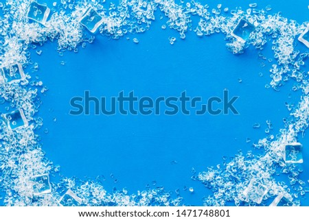 ice cubes frame on blue table top view mock up Royalty-Free Stock Photo #1471748801
