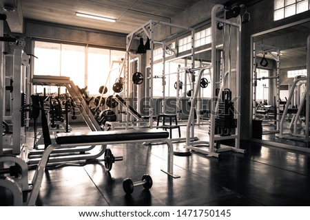 Within gym with modern fitness equipment for fitness events and more. Modern of gym interior with equipment. Sports equipment in the gym. #1471750145