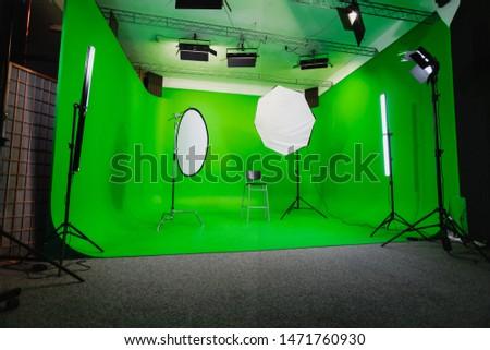 Interior of Modern Film Chroma Key Studio with Green Screen and Light Equipment #1471760930