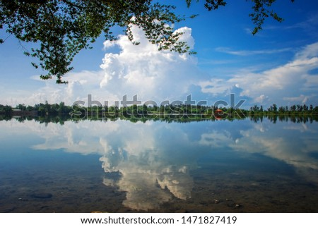 Reflections on Blue Sky and white clouds at Kolong Bandung, Belitung #1471827419