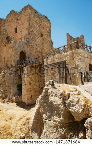 Ajlun, Jordan - August 19, 2012: Ajloun fortress ruins in Ajloun, Jordan. This ayyubid castle was built in the 12th century, used by crusaders and arabs.  #1471871684