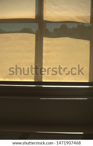 A window's yellow blind partially exposes the background #1471907468