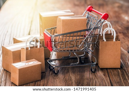 shopping online at home concept.Cartons in a shopping cart on a laptop keyboard.online shopping is a form of electronic commerce that allows consumers to directly buy goods from a seller over internet Royalty-Free Stock Photo #1471991405