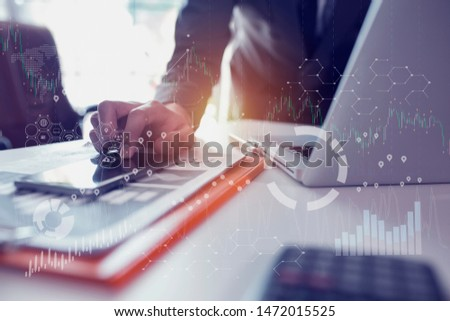 Businessman using a calculator with laptop and tablet on digital interface. innovation, icon and media information on network connection, Multi exposure, Concept of hight technology theme hologram. #1472015525
