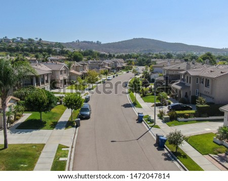 Suburban neighborhood street with big villas next to each other in Black Mountain, San Diego, California, USA. Aerial view of residential modern subdivision luxury house. 08/04/2019 #1472047814