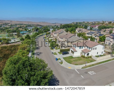 Suburban neighborhood street with big villas next to each other in Black Mountain, San Diego, California, USA. Aerial view of residential modern subdivision luxury house. 08/04/2019 #1472047859