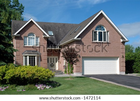 Generic contemporary upscale suburban brick house and manicured lawn #1472114