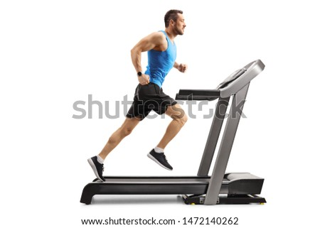 Full length shot of a young man in sportswear running on a professional treadmill isolated on white background #1472140262
