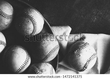 Old dirty rustic baseballs background in black and white.  Vintage style baseball equipment. #1472141375
