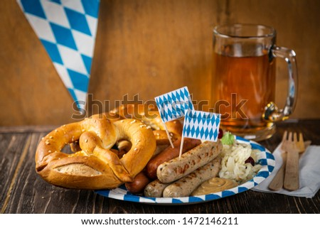 October fest concept - traditional food and beer served at event, wood background #1472146211