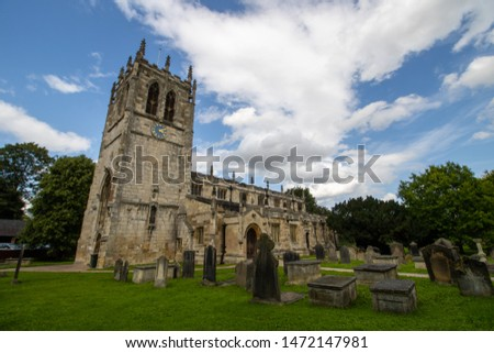 Old beautiful church on. a sunny day with white fluffy clouds in the sky. #1472147981