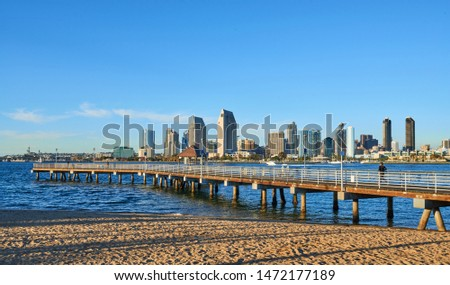 San Diego, CA / USA - February 26 2019:  Coronado Island Ferry Pier and Panoramic View Of Downtown San Diego  #1472177189