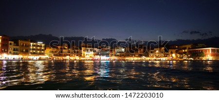 Crete, Greece October 01 2018 Panoramic view at evening of the historic city center from the inland sea at the port #1472203010