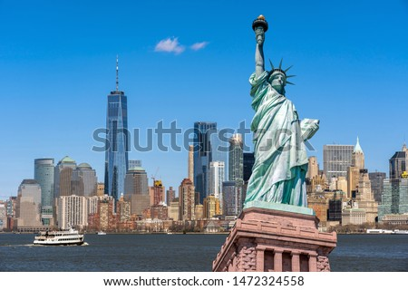 The Statue of Liberty over the Scene of New york cityscape river side which location is lower manhattan,Architecture and building with tourist concept #1472324558