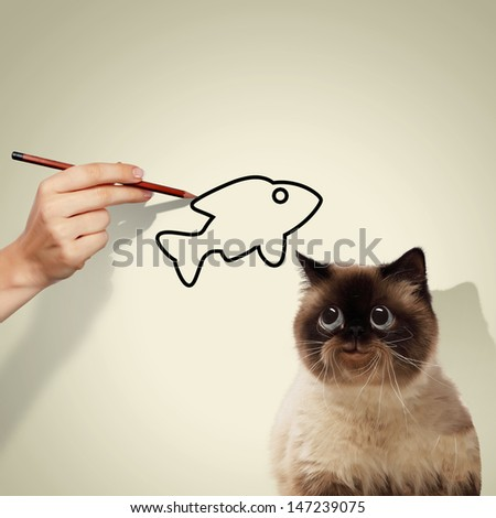 Image of siamese cat catching drawed fish