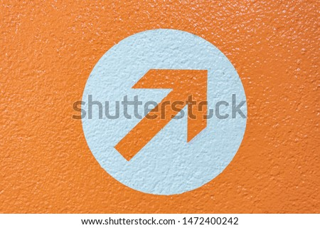 Vibrant orange arrow symbolizing a decision or choice to be made. Royalty-Free Stock Photo #1472400242