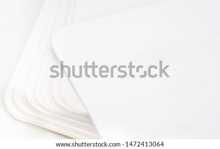 Stack of blank business cards цшер rounded corners on a white background