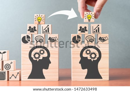 Knowledge transfer. Business knowledge management. Building wood blocks on table. #1472633498
