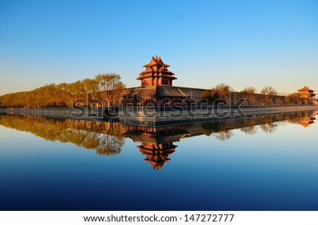 Imperial Palace over lake in the morning in Beijing.