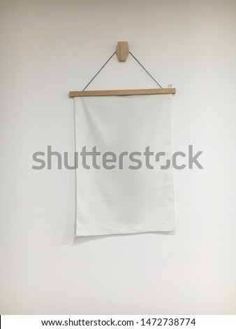 hanging banner on the wall