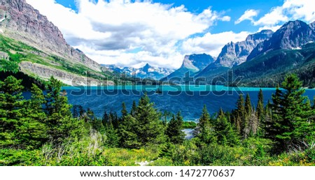 Beautiful scene of glacier national park with mountain range, Nature type lake mountains with blue sky and clouds, Amazing wonderful lake and mountains with nature view, #1472770637