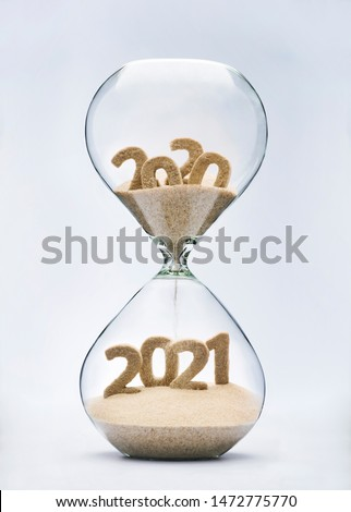 New Year 2021 concept with hourglass falling sand taking the shape of a 2021 #1472775770