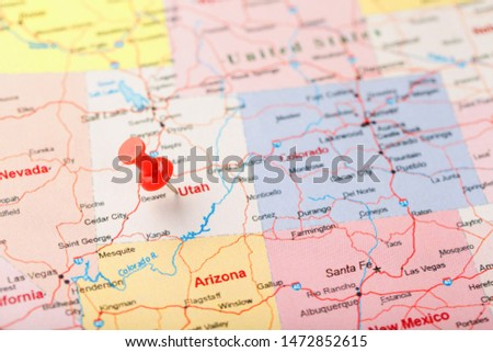 Red clerical needle on a map of USA, Utah and the capital Salt Lake City. Closeup Map Utah with Red Tack #1472852615
